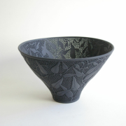Sandra Black, bowl from the 'Hardenbergia series', slip cast Seeleys ebony porcelain, carved, pierced and polished, 26x15.4cm; Collection of the Art Gallery of South Australia. Photo: Victor France.Sandra Black, etched black porcelain bowl.