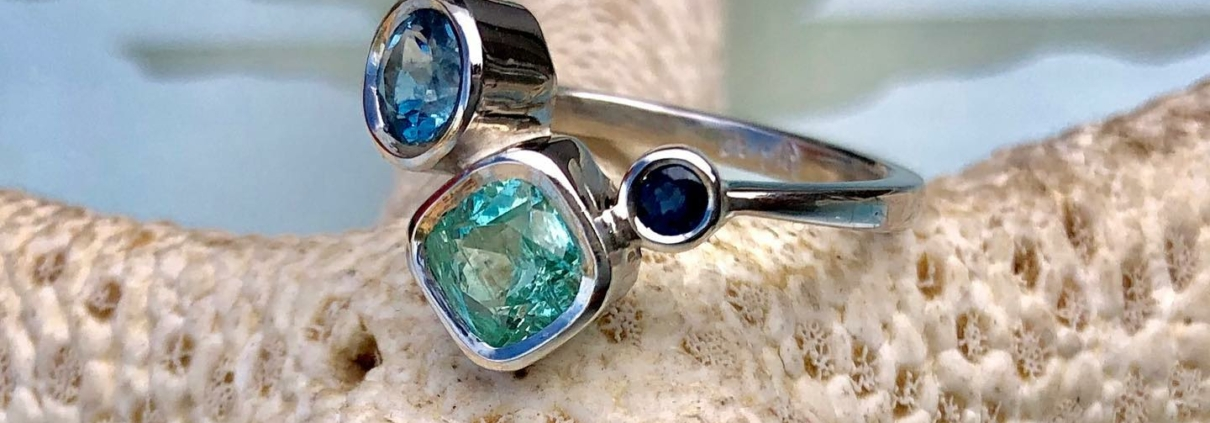 Bethamy Linton, engagement ring, platinum with ethically mined Torrington Emerald, Aquamarine and Sapphire
