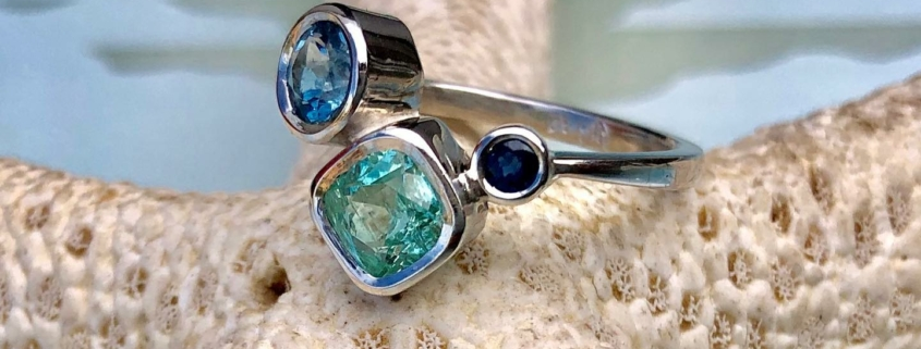 Bethamy Linton, engagement ring, platinum with ethically mined Torrington Emerald, Aquamarine and Sapphire