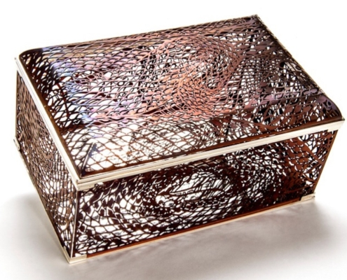 Bethamy Linton, King Brown casket, hand cut anodised titanium and sterling silver, 2013