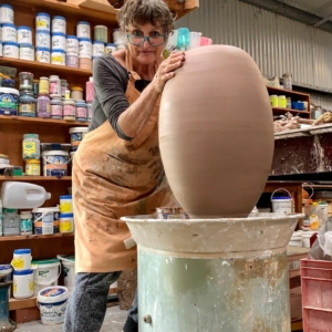 Robyn Lees busy in the studio with large pot