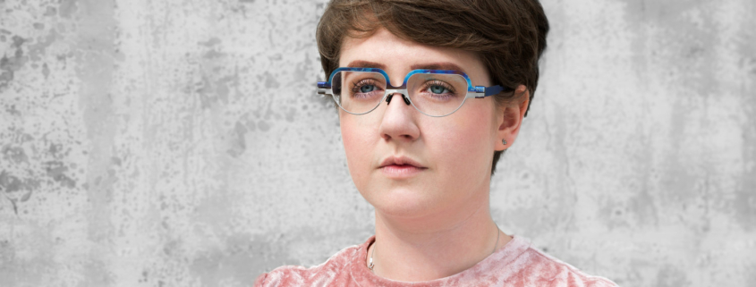 Megan Stewart wears custom designed SMEC Eyeware