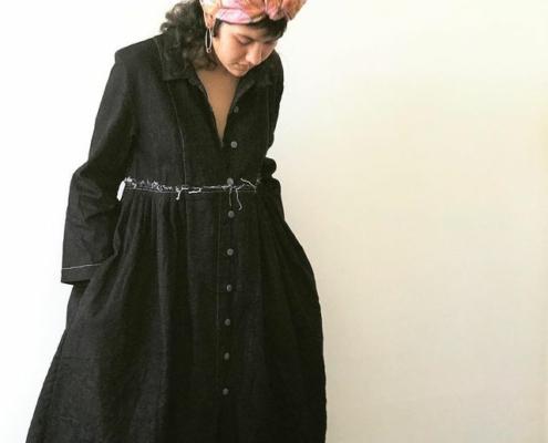 Model wearing Bukeshla classic, heavy denim dress